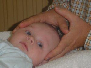 Osteopathie hoofdje handen